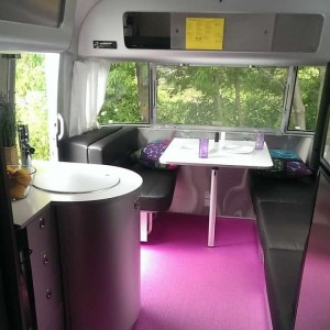 We might just need to have a purple floor, like this brand spanking new Airstream has, in our future rehabbed trailer. Or not.